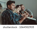 the four people with a pizza... | Shutterstock . vector #1064502935