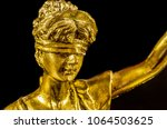 golden head of lady justice on...   Shutterstock . vector #1064503625