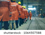 workers  helmets at the factory ... | Shutterstock . vector #1064507588