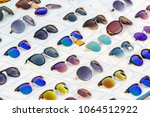 display of colorful sunglasses... | Shutterstock . vector #1064512922
