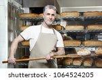 baker. a handsome baker with a... | Shutterstock . vector #1064524205