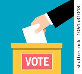 vote. hand putting paper in... | Shutterstock .eps vector #1064531048