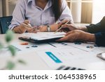 business people analyzing... | Shutterstock . vector #1064538965