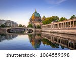 berlin cathedral reflected in... | Shutterstock . vector #1064559398