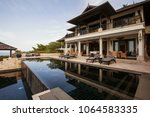 luxury tropical villa with big... | Shutterstock . vector #1064583335