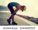 woman runner with sports... | Shutterstock . vector #1064600522
