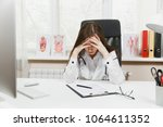 young tired exhausted woman... | Shutterstock . vector #1064611352