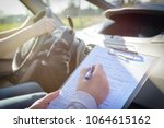 Examiner Filling In Driver\'s...