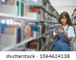 find books by tablet | Shutterstock . vector #1064624138