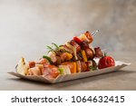 grilled skewers with sausage ... | Shutterstock . vector #1064632415