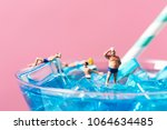 some miniature people wearing... | Shutterstock . vector #1064634485