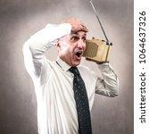 businessman listening to the...   Shutterstock . vector #1064637326