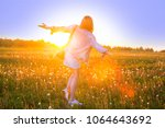 girl in a field of flowers at... | Shutterstock . vector #1064643692