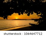 beautiful sunset on tropical... | Shutterstock . vector #1064647712