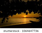 beautiful sunset on tropical... | Shutterstock . vector #1064647736