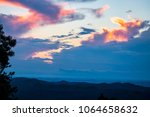 Stock photo a dramatic sunrise in the smoky mountains paints the clouds pastel colors 1064658632