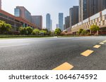 empty road with modern business ... | Shutterstock . vector #1064674592