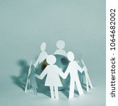 glass globe and the family... | Shutterstock . vector #1064682002