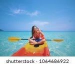 asian beautiful girl kayaking... | Shutterstock . vector #1064686922