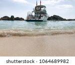 boat docked at beach bermuda | Shutterstock . vector #1064689982
