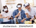 friends having fun on the couch ... | Shutterstock . vector #1064696435