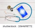 bitcoin symbol on mobile app... | Shutterstock . vector #1064698772