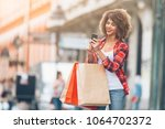 young woman at the street with... | Shutterstock . vector #1064702372
