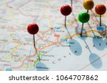 closeup of pins on the map... | Shutterstock . vector #1064707862