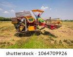 combine harvesters is working...   Shutterstock . vector #1064709926