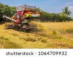 combine harvesters is working...   Shutterstock . vector #1064709932