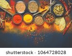 wooden table of colorful spices | Shutterstock . vector #1064728028