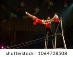 performance of aerialists in... | Shutterstock . vector #1064728508