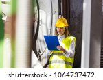 female quality control inspector | Shutterstock . vector #1064737472