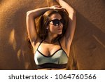 beautiful young woman lying on...   Shutterstock . vector #1064760566