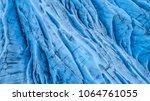 beautiful glaciers flow through ... | Shutterstock . vector #1064761055