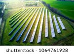 aerial view of solar panels on... | Shutterstock . vector #1064761928