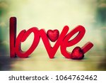 flowers with word love | Shutterstock . vector #1064762462
