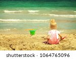 baby girl playing in the sand... | Shutterstock . vector #1064765096