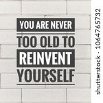 Small photo of Motivational and inspirational quotes quotes - You are never too old to reinvent yourself. With vintage styled background.