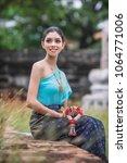 beautiful thai girl in thai... | Shutterstock . vector #1064771006