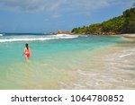 girl in red bikini on the... | Shutterstock . vector #1064780852