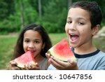 boyand girl eating watermelon... | Shutterstock . vector #10647856