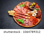 meat and cheese plate with...   Shutterstock . vector #1064789312