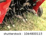 close up of a mechanical lawn... | Shutterstock . vector #1064800115