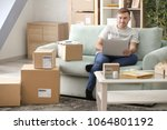 young man with laptop preparing ... | Shutterstock . vector #1064801192