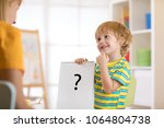 young child boy holding drawing ... | Shutterstock . vector #1064804738