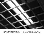 dark ceiling office light with... | Shutterstock . vector #1064816642