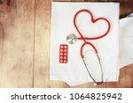 a stethoscope shaping a heart...   Shutterstock . vector #1064825942