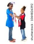 an elementary gilr helping her... | Shutterstock . vector #1064826392