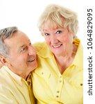 a senior man looking lovingly... | Shutterstock . vector #1064829095